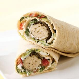 Dolmas wrap Ingredients 1/2 cup shredded romaine lettuce 1/4 cup chopped cucumber 1/4 cup chopped tomato 1/4 cup low-fat plain yogurt 1 tablespoon crumbled feta cheese 1/8 teaspoon garlic powder 1 whole-wheat lavash (see Note), or whole-wheat wrap 3 prepared dolmas (see Note) Preparation Combine lettuce, cucumber, tomato, yogurt, feta and garlic powder in a small bowl. To serve, spread the lettuce-yogurt mixture on the lavash, top with dolmas and roll. Tips & Notes Make Ahead Tip: Cover and refrigerate the lettuce-yogurt mixture for up to 1 day. Ingredient Note: Dolmas are stuffed grape leaves that are traditionally filled with chopped vegetables, grains and sometimes ground meat. Find prepared dolmas in cans or jars near other Middle Eastern ingredients and at some supermarket salad bars. Lavash is thin, Middle Eastern bread found near other wraps and tortillas. It's a great alternative to flour tortillas for rolling sandwich ingredients into a wrap. Depending on the brand and size, one serving may be one whole bread or half of the bread—check the nutrition panel on the back of the package. Nutrition Per serving: 384 calories;  4 g fat (  3 g sat ,  1 g mono );  12 mg cholesterol;  66 g carbohydrates; 15 g protein; 9 g fiber; 664 mg sodium; 360 mg potassium. Nutrition Bonus: Vitamin A (50% daily value), Vitamin C (20% dv), Calcium (17% dv). Carbohydrate Servings: 4 Exchanges: 3 1/2 starch, 1 vegetable, 1/2 low-fat milk, 1 fat