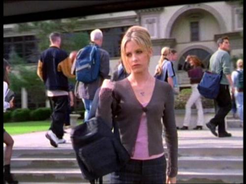 What Would Buffy Wear?: After Being Kept Up All Night By An Evil Alien-esque Back-Clinging Egg. Don't mind the tired face, Buffy seems to pull outfits together even with lack of sleep due to the worry of a crazed hellspawn egg monster crawling around her room all night. Is it just me, or did that give everyone the wiggins? Buffy's looking refreshed and pretty with plaid pants, a purple tank and a lovely grey cardigan. Another purple necklace and her cute, tiny backpack. Don't worry dear, we'll forgive the hair.