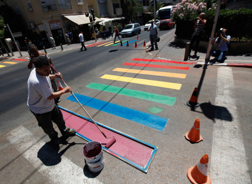 "Municipality workers paint a pedestrian crossing in the colors of a rainbow flag before the start of the annual gay pride parade in Tel Aviv on June 8, 2012. via LGBT Pride events)  Love this. Also, I was going to create a ""Rainbow"" hash-tag, but then I realized that obviously I already have one. I think I may have just been tagging things that I especially love with ""Rainbow."""