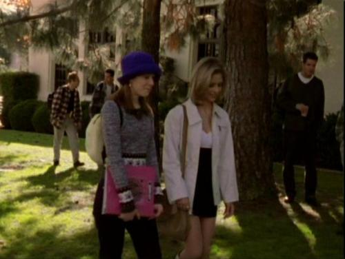 What Would Buffy Wear?: It's a Buffy Birthday Episode! The Birthday Girl looks just lovely in her black and white (surpriiiiise) mini dress with (surrrrPRIIIISE) what looks like knee high boots, a white jacket that's about the same length as her skirt, and a lovely over the shoulder tan purse. Boy, can that girl pull off white.