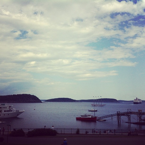 Paused for a moment to admire the view from Bar Harbor.   We timed coming into town just right: the cruise ship just departed.  It was a perfect summer day for a hike in Acadia National Park today and then a deep, cooling dive into one of its crystalline lakes.   Next step: a cold drink and a little editing. (Taken with Instagram at Agamont Park Bar Harbor)