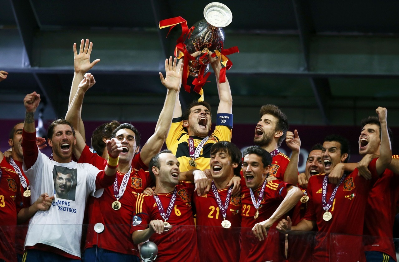 Spain's Iker Casillas lifts up the trophy after defeating Italy to win the Euro 2012 final soccer match at the Olympic stadium in Kiev, July 1, 2012. [REUTERS/Kai Pfaffenbach] More on this story at Reuters.com