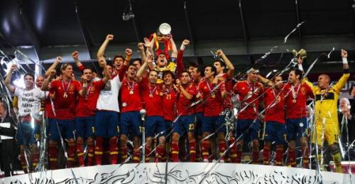 prettiestwords:  villageorge:   Iker Casillas of Spain lifts the trophy as he celebrates following victory in the UEFA EURO 2012 final match between Spain and Italy at the Olympic Stadium on July 1, 2012 in Kiev, Ukraine. (Photo by Laurence Griffiths/Getty Images)  Champions of Europe. Champions of the World. The greatest international side in recent history…are they the greatest of all time?  Yes. Yes they are.