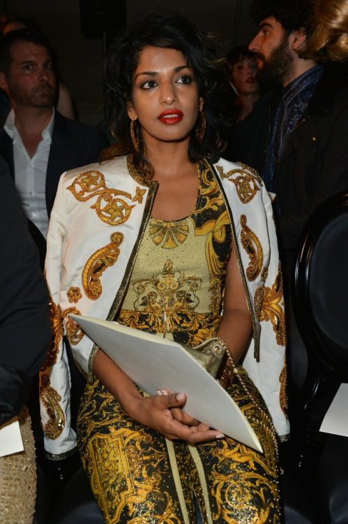 M.I.A. in a Vintage Gianni Versace printed outfit composed by gold printed lycra leggins, gold printed top and leather jacket. — at Ritz Paris.