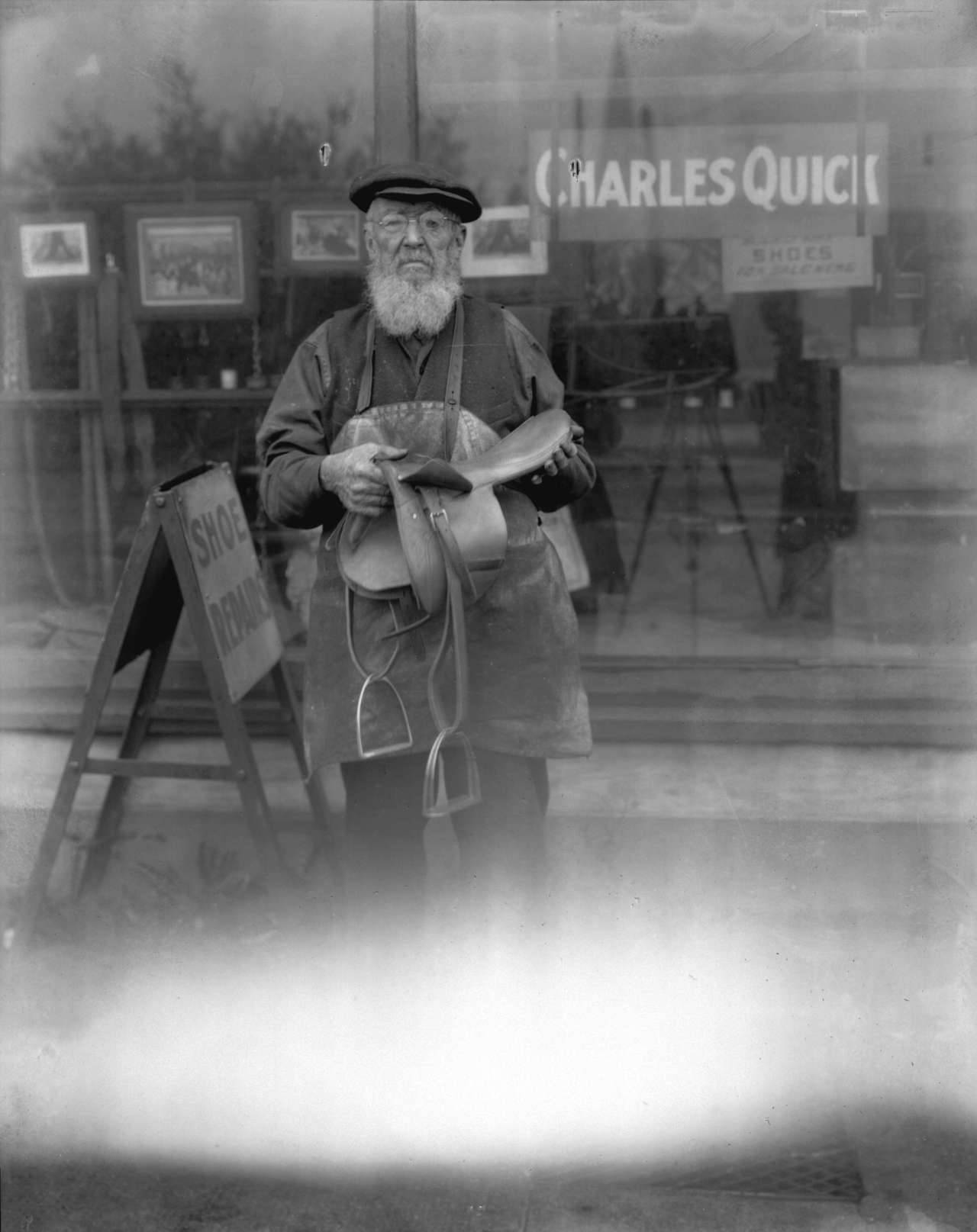 Charles Quick, 1920s Dad Quick outside his shoe repair/saddle making shop on Powell Street. Source: Photo by Stuart Thomson, City of Vancouver Archives #99-3197
