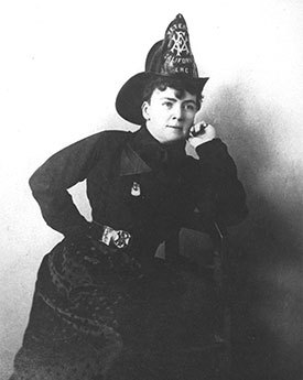 Lillian Hitchcock Coit, wearing a fire helmet