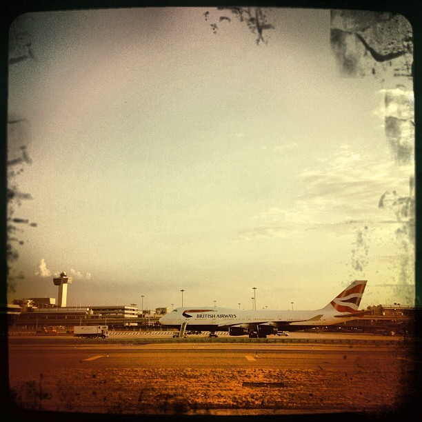 Parked 747 and tower (Taken with Instagram at John F. Kennedy International Airport (JFK))