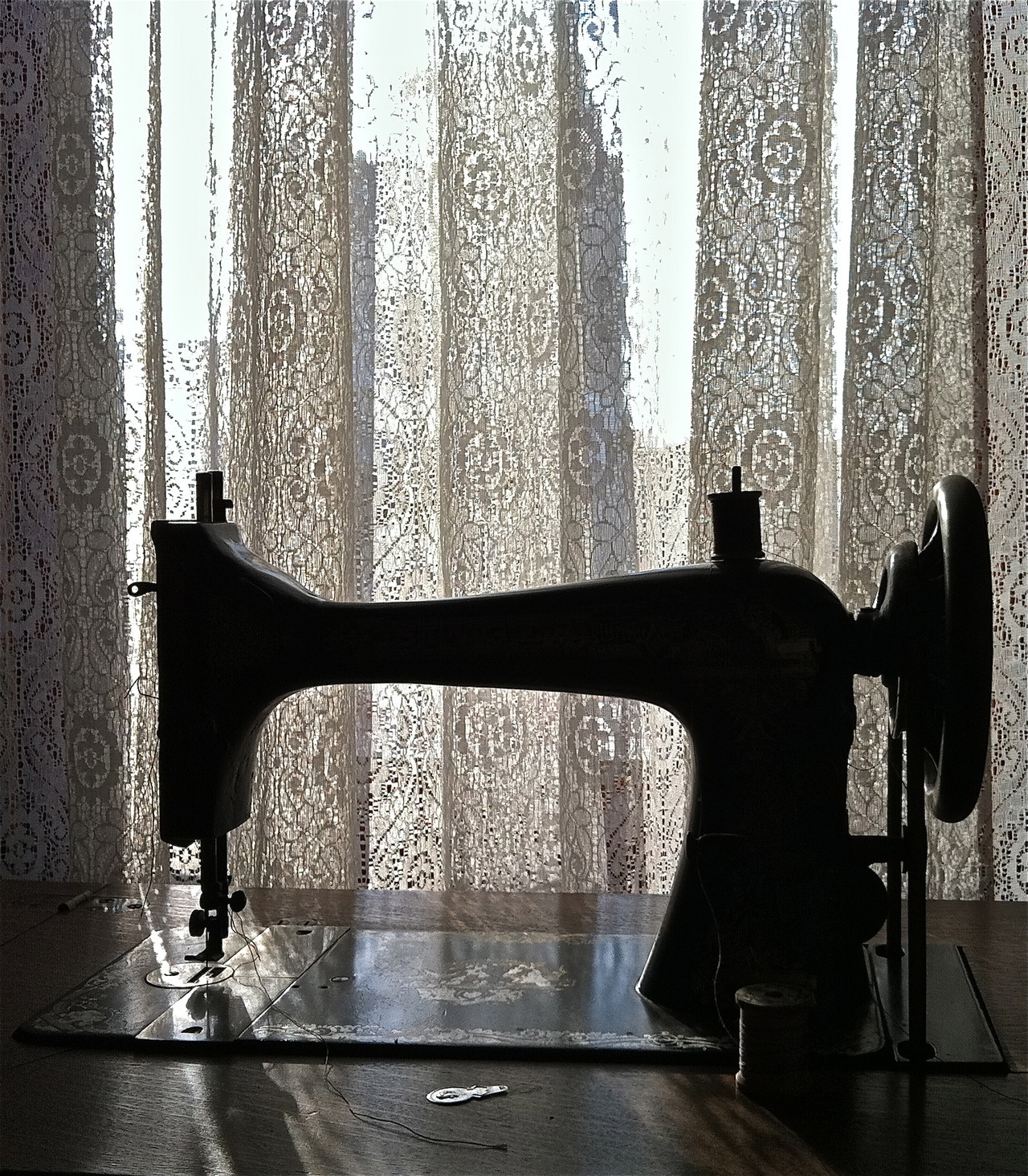 Domestic Art Silhouette of a late 19th century Singer sewing machine at the Rosson House Museum, an 1895 brick mansion in downtown Phoenix, AZ.