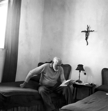 Ernest Hemingway reading at La Consula, Spain. via The Ernest Hemingway Collection