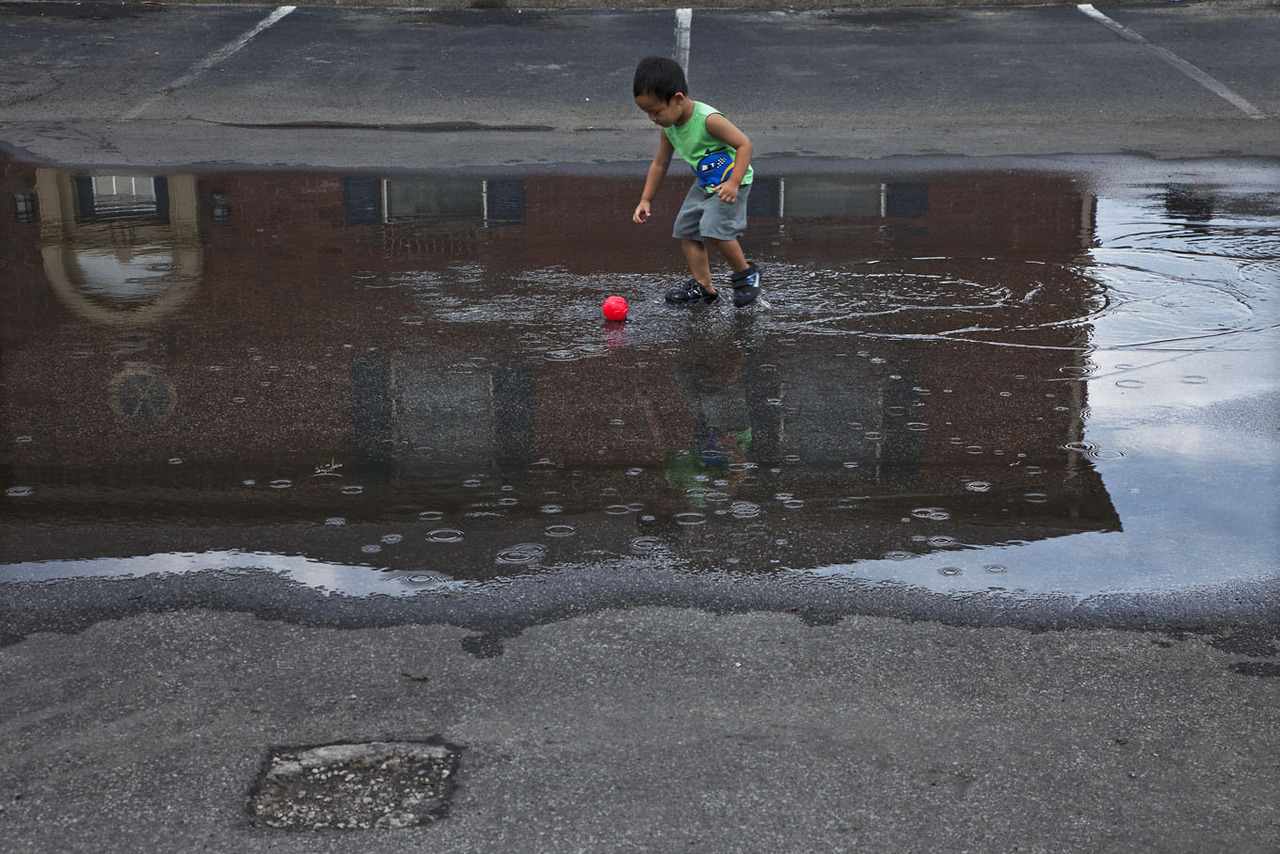 As a boy I loved to play in the rain puddles.  Never realizing or seen the reflections of my joy. Photographed June 30, 2012 photo credit & copyright Gary Dwight Miller