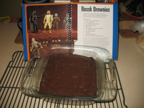 "Bossk Brownies (from The Star Wars Cookbook) jump to recipe Nathaniel, unsurprisingly, is a Star Wars fan. And Nathaniel owns a very entertaining book called The Star Wars Cookbook. No, really, he does.  We've made Wookie Cookies before, but this time Nathaniel really wanted the Bossk Brownies. I've had some bad experiences with brownies, but I decided to give it a go. For the boy. At the very beginning of this operation, I had two supercute helpers.  He has a Star Wars t-shirt on, plus he made the request, but it was Juliet who stuck with me at least as far as the dry ingredients. She started out by measuring the flour; she loves to scoop it into the measuring cups and then pour it in once I've leveled them off.  She saw me take out the cocoa powder and just as I got started measuring it, Juliet heard the call of her big brother. ""I'm going to go outside in the back yard and play with the hose."" Bye bye, little helper. I was on my own.  I added in the cocoa powder, baking powder, and salt.  Despite the instructions in the recipe to mix with a wooden spoon, I whisked. I can't help it, I'm a whisker. And then I added a little espresso powder, because I couldn't help that either. I just had to. In a separate bowl, I added the brown sugar & white sugar to softened butter.  Once that was properly mixed, I added the eggs and vanilla, and blended.  The batter felt a little too liquidy to me at that point, but I knew the dry ingredients were coming, so I kept going. Still, I was happy to dump in the flour & cocoa mixture.  That all mixed up into a proper-looking brownie batter. It was dark, and rich, and thick, and smelled like brownies. The recipe offered up the option of adding white chocolate chips or butterscotch chips; I went for the butterscotch.  There was a lot of talk about wooden spoons in the recipe, but I just used a spatula. Once it was all mixed, it looked pretty good. I poured it into an 8 x 8 glass pan, purchased just hours earlier on our big grocery shopping trip. I've been needing a square glass dish for ages and have resorted to using a pie plate in the past, but brownies really should be squares, and a pie dish is not square. The new dish was perfect.I smoothed the top of the batter as best as I could.  It looked just as good when it came out of the oven, and smelled great, although it took a lot longer to bake than the recipe suggested.  The texture was just perfect.  We took the kids out for dinner while the brownies cooled, and then I gave Nathaniel his with some vanilla ice cream, creating one very happy Star Wars fan. Juliet didn't eat them, of course, because they're chocolate, but Dave thinks they're pretty good too, although he misses the crackly top. I had a small piece of one myself, and it was rich and chocolatey and moist and good. A little goes a long way with these. And the butterscotch chips add just the right touch. The espresso powder did its job too, adding just a pinch of the Dark Side for depth of flavor.  I suspect the vanilla ice cream was the ideal accompaniment as well, bringing both sides of The Force together in harmony. As for this Bossk business, Bossk (I'm told) is a bounty hunter. I'm up on my Star Wars, but I had to look it up to remember his appearance in a particularly interesting storyline on Star Wars: The Clone Wars, which Nathaniel & I love to watch together. He also showed up in earlier (real) Star Wars, in a failed attempt to capture Han Solo & Chewbacca. Yet here he is, triumphant on his namesake brownies:  Bossk Brownies (from The Star Wars Cookbook)  Ingredients: 2/3 cup all-purpose flour1/2 cup unsweetened cocoa powder1/2 teaspoon baking powder1/2 teaspoon salt1 (scant) teaspoon espresso powder (optional) 1/2 unsalted butter, at room temperature1/2 cup packed brown sugar1/2 cup granulated sugar. 2 large eggs1 teaspoon vanilla extract1/2 cup white chocolate or butterscotch chips Preheat the oven to 350 degrees F. Butter or spray an 8-inch square baking dish. Put the flour, cocoa powder, baking powder, and salt in a small bowl. Stir with a wooden spoon (or a whisk) until well mixed. Set aside. Put the butter, brown sugar, and granulated sugar in one large bowl. Using the electric mixer set on high speed, beat together until well blended and creamy, about 3 minutes. (You can do this with the wooden spoon, but it will take longer.) Beat in the eggs and vanilla extract. Add the flour mixture and stir until blended. Stir in the white chocolate or butterscotch chips. Pour into the prepared baking dish and smooth the top with a rubber spatula. Using pot holders, put the baking dish in the preheated oven. Bake until a toothpick inserted into the center comes out clean, about 25 minutes. (For me it was closer to 35, maybe 40.) Again using pot holders, transfer the dish to the cooling rack. Let cool completely. Makes about 16 brownies."
