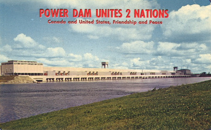 POWER DAM UNITES 2 NATIONSCanada and United States, Friendship and Peace UNITED WE ELECTRIFY  MOSES—SAUNDERS POWER DAMSpanning the International Border from Barnhart Island in the U.S. to Canadian mainland, the dam, 3,216 feet long, houses 32 turbines to produce electrical energy for both countries.  __________ BAD POSTCARDS celebrates CANADA DAY