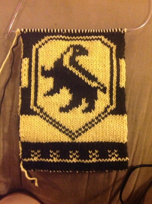 Huzzah Hufflepuff! I wanted to do a scarf with this badger pattern on the front and this pattern on the back but to do that, you have to carry the black in between the yellow… and it made the yellow darker and I didn't like it. So, I just double knitted it. Not a big fan of the yellow badger with black markings on the back, though. Not sure what I'm going to do about that. I'm thinking about buying some quality yarn and redoing it. Maybe on smaller needles, too. Ah, well. I'll figure something out!