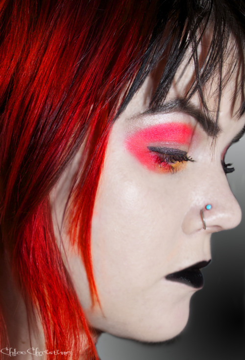 black lipstick & red/orange eyeshadow. gothic chic