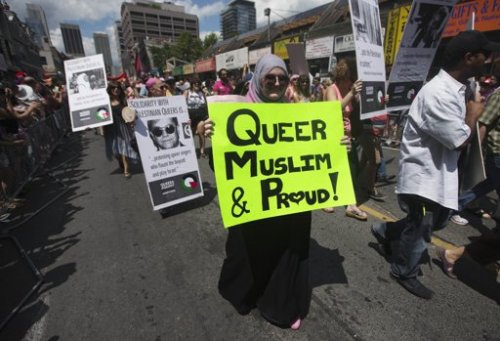 I am not too scared to post this. I am queer, Muslim, and proud. This was taken of me today marching in gay pride Toronto 2012 with QuAIA (Queers Against Israeli Apartheid). I am not ashamed.