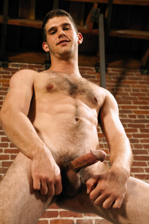 Naked hairy frat boy with a hard boner.