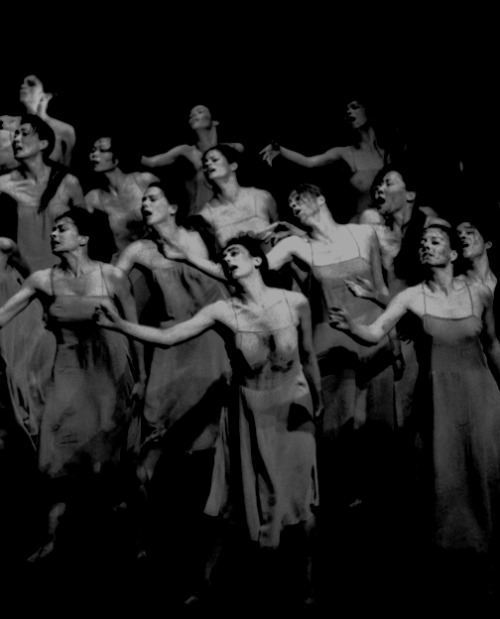 "Frühlingsopfer (Rite Of Spring), choreographed by Pina Bausch, music by Igor Stravinsky, 1975. Photo by Maarten Vanden Abeele ""In her setting of Rite, she returns Stravinksy's music to its most primitive logic by covering the stage in thick dark earth and by choreographing on a huge scale. Some 32 dancers confront each other in thudding convulsive groups, ranked across a sexual divide. As they unite in great wheeling circles then scatter into a collective frenzy of coupling, Bausch makes it appear as though they are galvanised by some savage, biological imperative. As they run and fall, dirt smears their sweaty bodies. By the time the chosen maiden (Ruth Amarante) is led towards her sacrificial solo, she seems to be only thing standing against her tribe and their absolute terror of extinction. Her dread and her ecstasy leave us shaking."" Watch Rite of Spring (opening)"