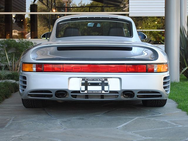 "Porsche 959 | Sequential Twin Turbos | Four Wheel Drive | 1986-1989 Interestingly, the Porsche 959 started out as a Group B project before it became Porsche's legendary supercar of the late 1980s. In 1981, Porsche's head engineer Helmuth Bott wanted to expand on the 911 as well research and develop an all wheel drive system for Porsche. (edit, as per @that911's input:) Another significant reason for the development of the 959 was to explore the limits of Porsche's ""incorrectly"" placed rear engine. Bott chose Group B as the testing grounds for the car and used the racing program to accelerate development. Most of the work at the start of development went into designing the all wheel drive system and the suspension to cope with all four wheels being driven. While mechanically the all wheel drive system wasn't anything revolutionary, the ingenious component was the computer that controlled where the power would be sent. The computer did so via the PSK's (Porsche-Steuer Kupplung, Porsche's name for the all wheel drive system) clutch between the transmission and front differential and was smart enough to compensate for weight shift during acceleration and to adapt to different surfaces such as gravel, ice, or snow. At the time, this was the most advanced all wheel drive system on a production car. Porsche also employed use of an anti-lock braking system on the 959, using an existing ABS that was completely redesigned (caliper pictured above) due to complications involving the all wheel drive system.  Being Porsche, the design of the car was supposed to maintain the basic shape of a Porsche 911 while keeping the weight of the car down, along with the drag coefficient. The designers did an amazing job at all of this while adding an elegantly integrated rear wing and ending up with a drag coefficient of 0.32, in part due to the enclosed underbody design. While having a very strong and durable monocoque and drivetrain, along with the all wheel drive system and being packed with technology, the finished ""Comfort"" production car weighed in at 3,197 lbs (1450kg), with a ""Sport"" version that weighed just over 220 pounds (100kg) less. The engine used was the 2.85L flat six that had been previously designed for use in the 935/78 Moby Dick race car. The engine consisted of an air-cooled block with watercooled heads that made use of 4 valves per cylinder and twin camshafts. The engine, helped by sequential twin-turbochargers made a very impressive 450 hp and 369 ft·lb of torque and, in the road car, was mated to a 6-speed manual transmission. While Group B was mostly only a way to test the cars, the Group B 959s eventually had a few successful races, taking first place in Dakar in 1984, and finishing first, second and sixth in 1986. The focus was then moved to refining the 959 as we know it, a blisteringly fast yet elegant supercar. The first car wasn't shipped until 1987 with a final price of $225,000, which would have bought you a Countach and a Tersarossa in those days. Even so, Porsche was still losing money on each of the 250 cars built for customers, with a total of 337 cars built including prototypes. Also interesting was Porsche's refusal to meet emissions and safety standards of the United States, resulting in the US Customs Service holding Bill Gates' 959 for 13 years until the ""Show and Display"" law was passed in 1999. More important than the price, though, was the performance of the machine. The 959 Sport made it from 0-60mph in 3.6 seconds, in part due to the reduced turbo lag with the sequential turbo setup as well as the extremely smart and grippy all wheel drive system. The 959 continued on up to 100mph in around 8.5s and with a top speed of nearly 200mph, it was the fastest car in the world at the time. The 959's one-off racing variant, the 961, won first in class and 7th overall in the 1986 24 Hours of Le Mans before catching on fire after an accident the following year. The 959, however, was the original high-tech supercar and remains a symbol of Porsche's beautiful and brilliant engineering, with the technology developed for the 959 used on a variety of 911s in the years to come. (Sources: ultimatecarpage.com (along with the pages on the Sport, Dakar and 961), Wikipedia, insideline.com)"