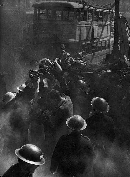 London 1944 - rescue workers pull a victim from a building hit by a V2 rocket