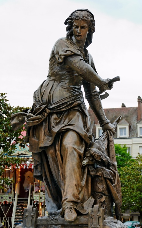 "Statue en bronze de Jeanne Hachette par Gabriel-Vital Dubray (1813-1898), sur la place de Beauvais qui porte son nom. @credits  Jeanne Laisné (born 1456) was a French heroine known as Jeanne Fourquet and nicknamed Jeanne Hachette ('Jean the Hatchet').  All that she is currently known for is an act of heroism on 27 June 1472, when she prevented the capture of Beauvais by the troops of Charles the Bold, Duke of Burgundy. The town was defended by only 300 men-at-arms, commanded by Louis de Balagny. The Burgundians were making an assault, and one of their number had actually planted a flag upon the battlements, when Jeanne, axe in hand, flung herself upon him, hurled him into the moat, tore down the flag, and revived the drooping courage of the garrison. In gratitude for this heroic deed, Louis XI instituted a procession in Beauvais called the ""Procession of the Assault""."