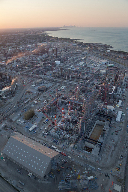 busfolklivin:  groovesoul:  BP Whiting Refinery to Downtown Chicago by metroblossom on Flickr.  NWI  BP in Whiting: Giving you gas that'll fuck up your car and dumpin' large amounts of mercury into your lake