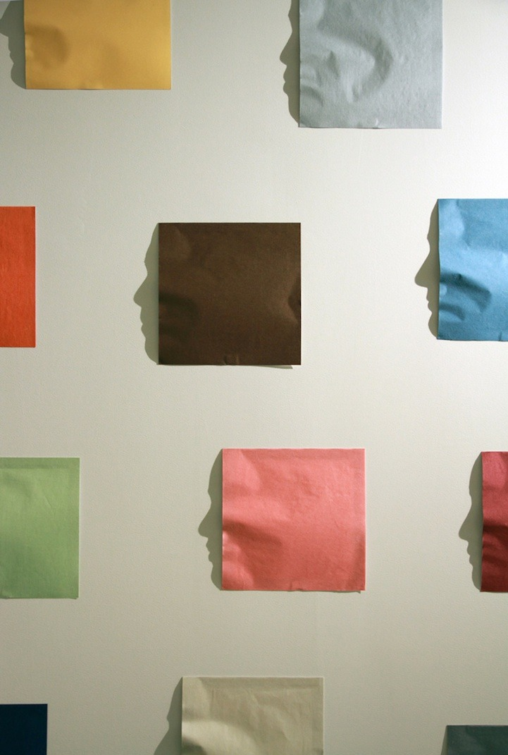 Origami Shadow Art of Actual Faces Though at first glance you'd think you were just looking at a bunch of colorful construction paper pieces neatly arranged on a blank white wall, come a little closer and you might notice a familiar face. Back in 2011, famed shadow artist Kumi Yamashita (who we wrote about here and here), was commissioned by American Express to create a unique work of art for their Tribeca, New York office lobby. She first invited all American Express employees to be a part of her installation by taking a photo of their profile. Since the size of the space only allowed for 22 pieces, Kumi then chose 22 employee faces. Then, right on site, she worked with shadows and light to create these origami style pieces that, when hit with just the perfect light source, reveal actual faces! (via Origami Shadow Art of Actual Faces - My Modern Metropolis) The Artist website: http://www.kumiyamashita.com/