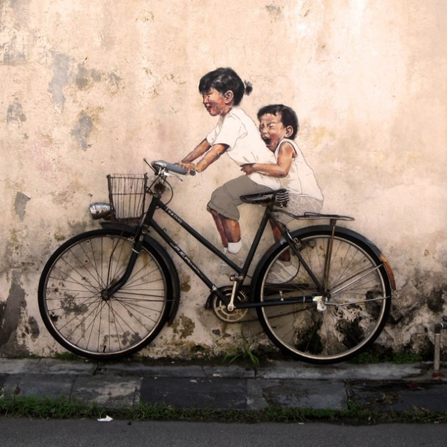 thisiscolossal.com Painter Ernest Zacharevic created new works where his painted figures of mischievous children are seen interacting with their physical surroundings.