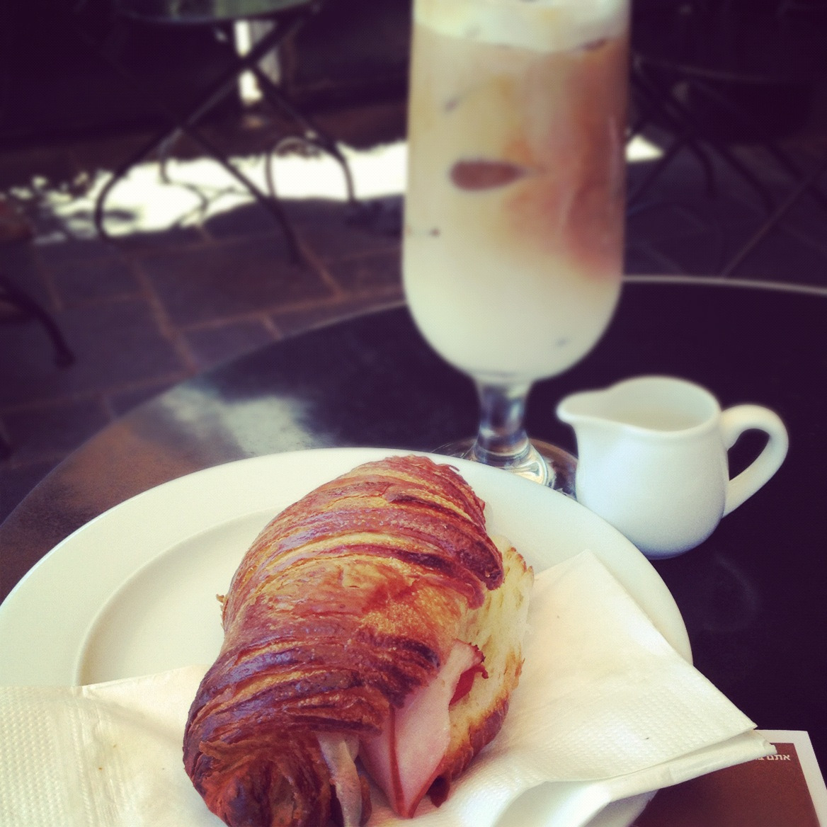 Lunch @Bakery - toasted croissant with ham and cheese and a side of iced cappuccino.