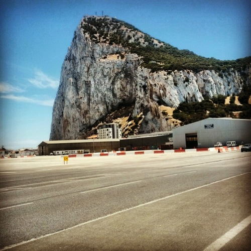 To get to the heart of Gibraltar, you have to walk across the Gibraltar Airport's only runway, which runs perpendicular to the peninsula across the entire territory.