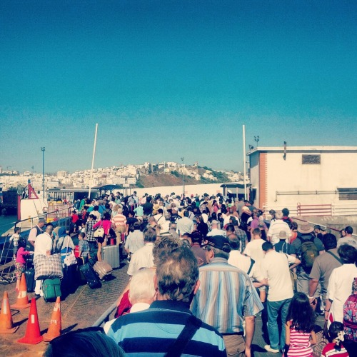 The throng of people trying to get off the ferry at the Port of Tangiers.