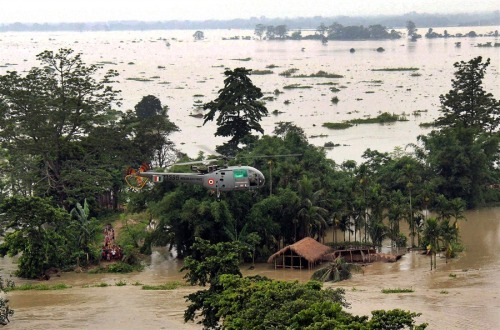 Floods strand villages, kill 77 in India's Assam state Reuters:  At least 77 people have been killed and nearly 2 million affected by heavy monsoon rains that caused floods in India's northeastern Assam state, in what the prime minister on Monday called one of the worst such disasters to strike recently. Authorities have given shelter, food and medicines to thousands of homeless people, and deployed mobile medical teams to prevent the outbreak of disease.  Photo: An Indian Air Force helicopter distributes relief materials at a flood hit area in Sonitpur, Assam, India, on July 1, 2012. (AP)