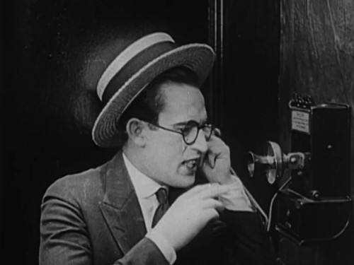 "Harold Lloyd trying to get past the operator in ""Number, Please?""."