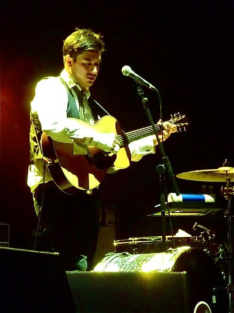 Marcus Mumford of Mumford & Sons plays guitar with his broken hand at Hurricane Festival on 23rd June 2012. Photo courtesy of Christoph.