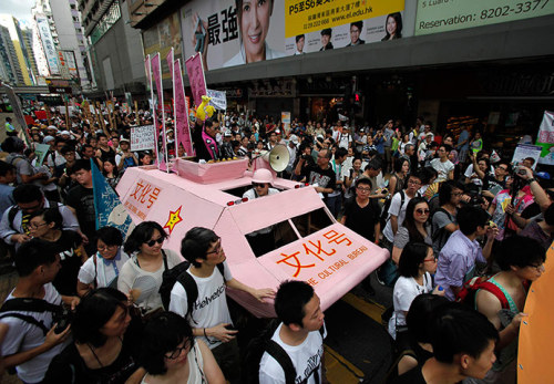Hong Kong protests - in pictures  THE GUARDIAN - Fifteen years after British colonial rule ended and China regained control of the city, tens of thousands of protesters took to the streets in the annual pro-democracy march. Protesters chanted slogans against new Hong Kong Chief Executive Leung Chun-ying just hours after he was sworn in.