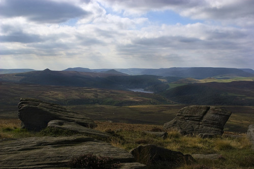 Ladybower from Stanage Edge on Flickr. Stanage Edge is part of an outcropping of millstone grit (the local course sandstone), part of the same ridge that winds its way through the landscape forming Curbar and Froggat Edges to the South, through Burbage, Stanage, and High Neb. The gritstone gives the Dark Peak its name; it forms a cap that sits atop the limestone visible in the White Peak part of the national park, and can be a bleak, wild place. Much of it has never been wooded, being too high and windswept for trees to colonise since the glaciers retreated from the area a little over six thousand years ago. Most of the area is covered with tough grass and heather, with the characteristic jut of the grey boulders, carved by wind and rain. The soil is peaty (many of the rivers and streams run the colour of tea), but shot through with sand from eroded conglomerate and is often more boulder than soil. This lack of utility for agriculture is why the area is still a wilderness; only the tough sheep can make use of the land, and even then the meagre herds stretch over large areas to find sustenance.  As a child most summer weekends would involve a trip out here, a bus ride out of the city with potted meat sandwiches and bottles of pop which would be placed in a stream to keep cool while I and all my friends that my mother had rounded up would explore and climb, seeing who could travel the furthest without stepping on soil or grass or swarming up some of the great up-ended slabs of rock like mountain goats. If I ever move away it will have to be to somewhere with comparable terrain, and this place will still live in my bones.