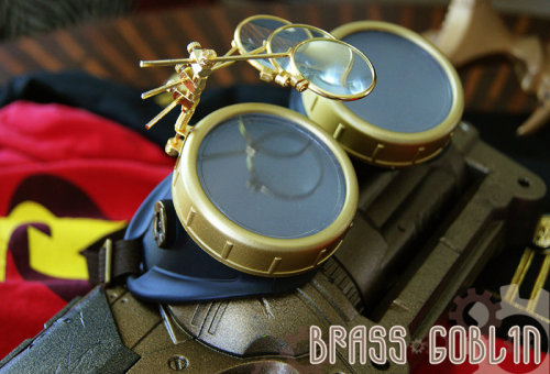brassgoblin:  Here are the first pair of goggles in my exclusive Steampunk Young Justice series. These are for Steampunk Robin. I will be cosplaying as Robin for Otakon 2012. I'm also working on a steampunk grapling gun (seen in the pic based on a Nerf Maverick.)  My husband made these cool goggles for his Robin cosplay at Otakon ^^