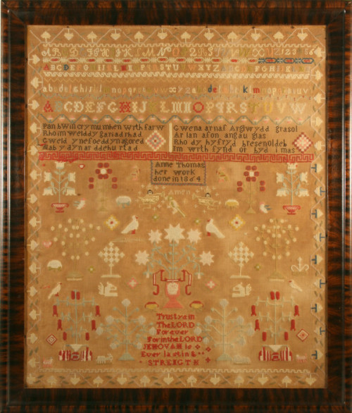 "wiscohisto:  Cross-stitch sampler by Anne Thomas, Wales, 1864. This needlework sampler, which includes two verses in Welsh and one in English, was stitched by Anne Thomas of Wales. Anne's daughters Mary and Elizabeth came to Wisconsin in the 1890s, joining other relatives who had previously settled in the Waukesha area. The first Welsh immigrants to Wisconsin arrived in 1840.  via: Waukesha County Museum by way of Wisconsin Decorative Arts Database read more: Sadie Rowlands Price, ""The Welsh of Waukesha County,"" Wisconsin Magazine of History 26:3 (1943)"