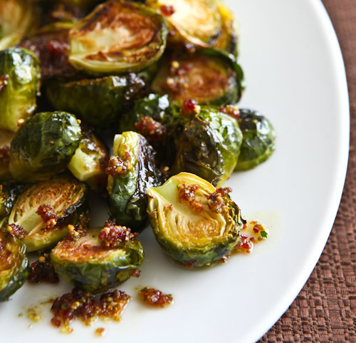 mytongueissmiling:  Roasted Brussels Sprouts with Cranberry Pistachio Pesto