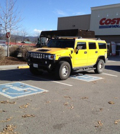 Hummer Parked Sideways Across Handicapped Spot He's trying to get his idiot driver license.