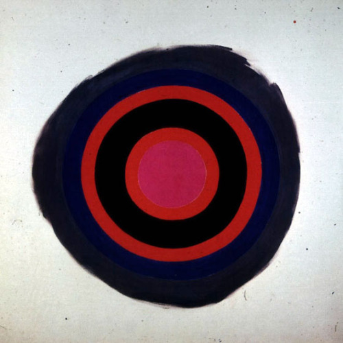 """Kenneth Noland's paintings were based on the simplest patterns, target, chevron and stripe. In the best of his target paintings, like Song, he could set a splashy grey rim whirling around concentric circles of red, black and blue with an airy energy that few American painters could equal. Like gigantic watercolours his targets and chevrons bloom and pulsate with light; they offer a pure, uncluttered hedonism to the eye."" - The Shock Of The New, Robert Hughes"