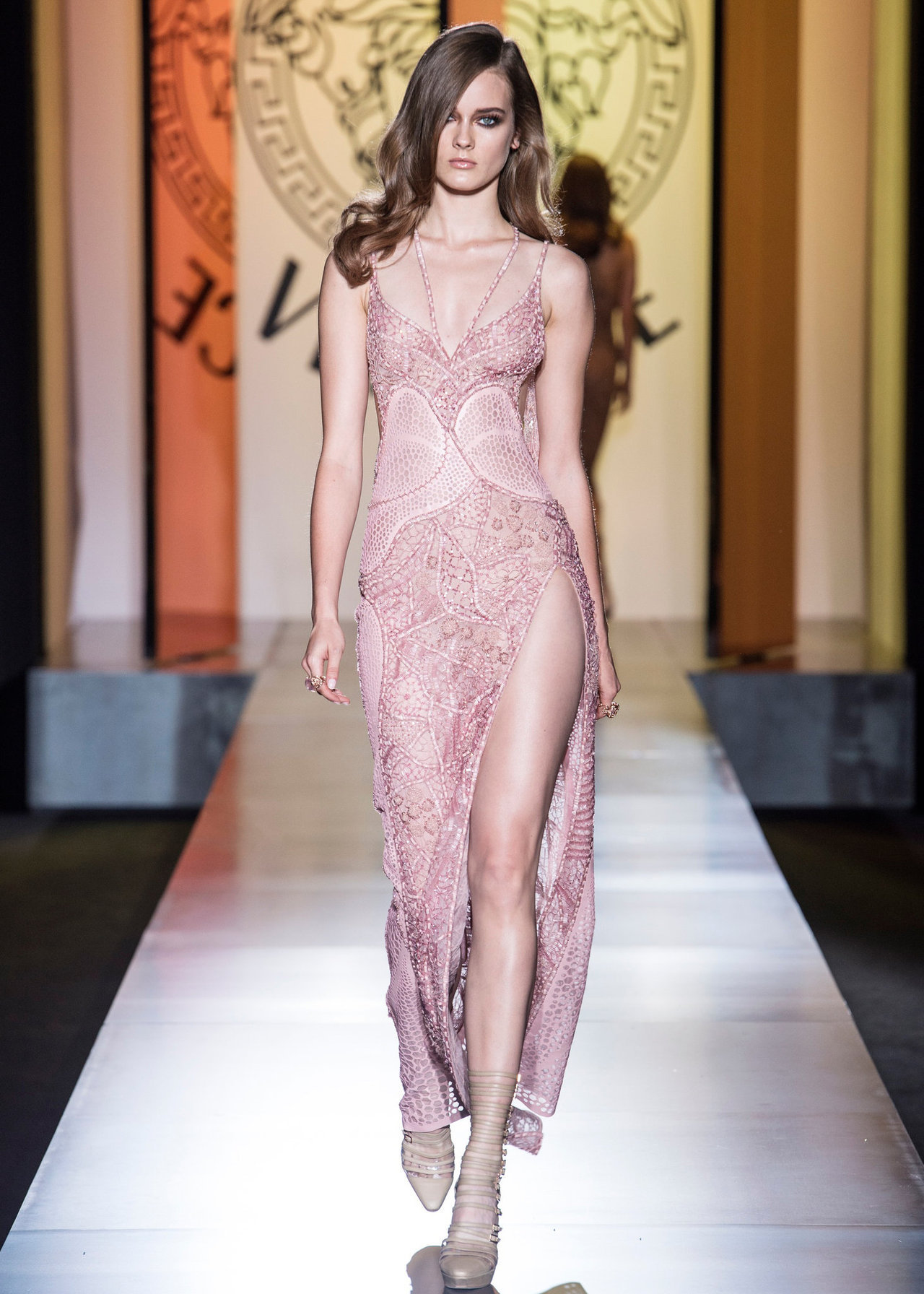 Our favorite look from Donatella Versace's first proper haute couture show in years is this showgirl-takes-the-red-carpet dress.