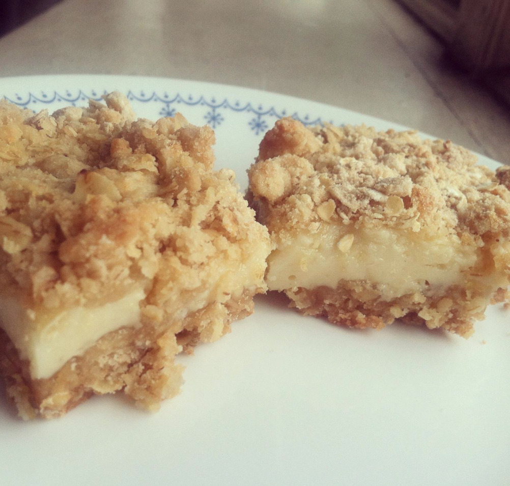 thissadbaker:  When life has lemons on sale, makes lemon oat bars. These are super easy. A little too easy, if you ask me. I can picture myself making them nonstop. Light and chewy. Perfectly paired up with a cup of coffee. Plus its healthy because of the oats right? The original recipe can be found here: Bam!1 can of sweeten condensed milkZest of 1 lemonJuice of said lemon1 cup oats1 1/4 cups flour1/2 cup of soften butter1/4 teaspoon of baking soda1/4 teaspoon of saltHeat oven to 375F degrees.Coat 8x8 inch pan with non-stick cooking spray.Mix milk, lemon zest and lemon juice in medium bowl until thickened; set aside. Mix remaining ingredients in medium bowl until crumbly.Press half of the crumbly mixture in pan; bake about 10 minutes or until set.Spread lemon milk mixture over baked crust. Sprinkle remaining crumbly mixture over the lemon milk mixture, press down gently.Bake about 20 minutes or until edges are golden brown and center is set but soft. Cool completely. Cut 4 rows by 4 rows.  Reblogging for future reference. It's only a matter of time before it's either cool enough to use my oven again or I'm so deep wallowing in self pity that I don't care that turning my oven on will make my apartment approximately 2000 degrees.