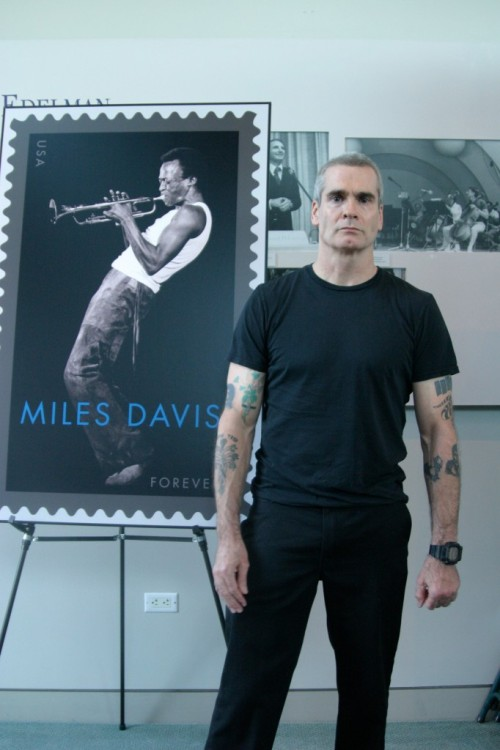 "jazzinbooks:   Henry Rollins on Miles Davis- ""There's nothing more American than jazz music, there's nothing more American than Miles Davis…If you think for a moment all the different ways he changed his music with his career behind him and his artistic integrity in front of him, at all times, what some people would think is a risk, for Miles Davis was just another day of his creative muse. And a long time ago when Miles Davis started playing music, this country had an awful disfunction: which we're working past, we're getting better all the time, and bebop music is one of the most important and most powerful nails in the coffin of racism and inequality in America. And the great players like Charlie Parker, Dizzie Gilespie, Miles Davis and many others, they got right in the teeth. Amazing players playing amazing music and being told they can't walk over a certain line painted on the floor of the dance club because they were the wrong color. As you know, famously, Miles Davis would often walk over the painted line on the floor, find the club owner, and glare at him, defining him to do something about it. By doing that, by that brave act, that is how you effect change in this country."""