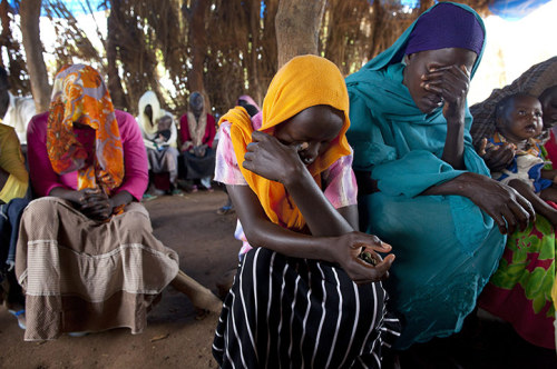 Sudanese refugees listen to a sermon at a makeshift church at the Yida refugee camp in South Sudan, close to the border with Sudan. The camp has swollen to nearly 60,000 as refugees flee from South Kordofan in Sudan, with 300 to 600 new arrivals a day. The rainy season has increased the numbers of sick children suffering from severe malnutrition as the international aid community struggles to provide basic assistance to the growing population. Photograph: Paula Bronstein/Getty Images