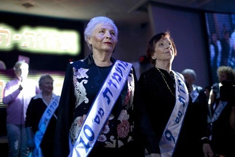 "newyorker:  Israel's Miss Holocaust Survivor Beauty Pageant: http://nyr.kr/LfHXC6  The pageant was worse than tasteless in the eyes of many. (""Ghastly"" and ""macabre"" were among the adjectives used to describe it.) But the next morning, I got an e-mail from a friend of mine in the movie business. ""I thought, at first, this had to be a satire,"" he wrote. ""You cull a minion's worth of good-looking old Jewish ladies from a big pool of less desirable specimens; you put them on show wearing blue numbers; and the prize for the best story of their ordeal is a weekend at a fancy hotel? It's like 'Springtime for Hitler.'"""