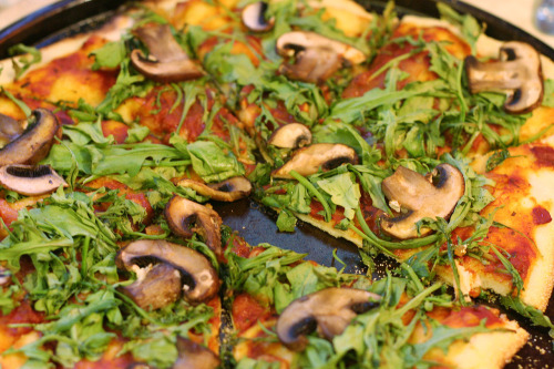 i made five pizzas for vegan pizza day 2012. here's the first: mushroom and arugula with a sundried tomato/oregano/bay tomato sauce on thin crust. [FIVE pizzas?  You're my hero, Malloreigh! - ed.]