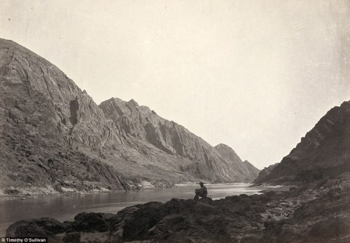 raggedglory:  Timothy O'Sullivan:  A man sits on a shore beside the Colorado River in Iceberg Canyon, on the border of Mojave County, Arizona, and Clark County, Nevada in 1871 during the Wheeler expedition. Lieutenant Wheeler insisted that the team explore the Colorado River by going upstream into the Grand Canyon—apparently to beat a rival, who had first gone downriver in 1869. There was no particular scientific reason to do the trip backward. (Big up to melancholiceuphoria for sending these my way!)