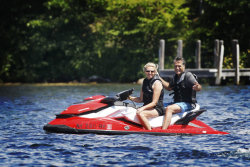 Ann Romney drives the jet ski in this family.