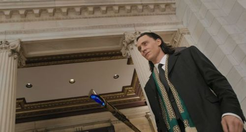 Stuttgart State Opera, Cleveland, Germany[Loki pimps on into Der Fancypantsenpartyein, which is terrible fake German and yet more than anyone speaks in this scene.]  LOOK AT THIS GQ MOTHERTRICKSTERHIS SCARF IS FLY AND SO ARE HIS DADDY ISSUESDAMN  (via m15m: The Avengers in Fifteen Minutes)