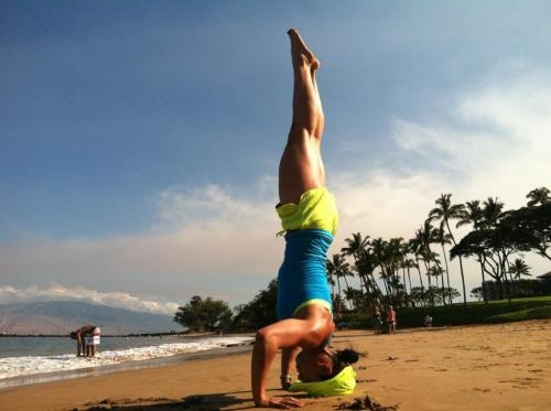 One of our own, Tara, doing a headstand in Maui. Looking great in our Seamless Racer Tank. We are all very jealous right now. ; )